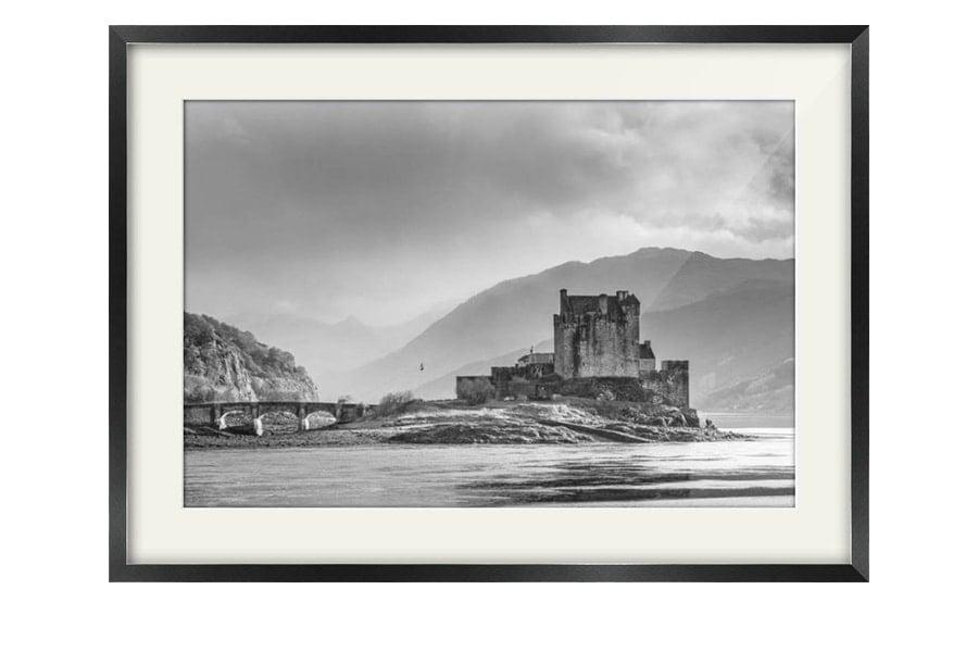 Eilean Donan Black and White Storm Black Framed Print