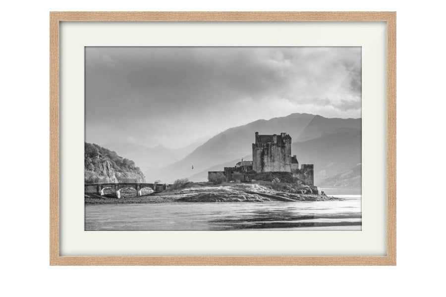 Eilean Donan Black and White Storm Oak Framed Print