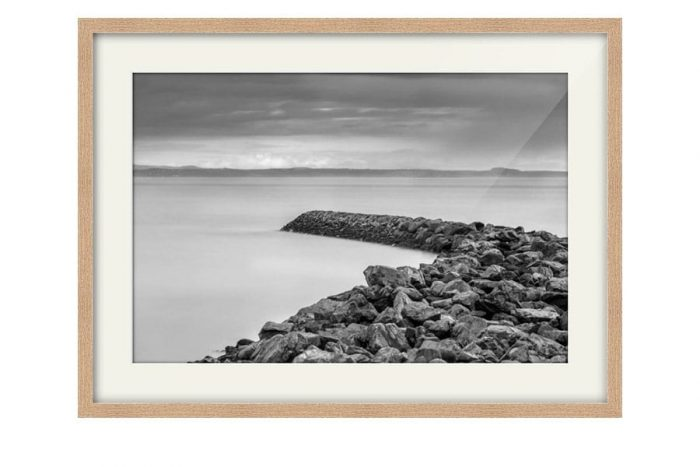 Garlieston Defences Black and White Oak Framed Print